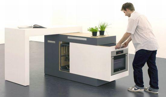 zMini small type modular kitchen dei designer tedeschi Kristin Laas e Norman Ebelt si trasforma in un piano da appoggio che può diventare il tavolo stesso