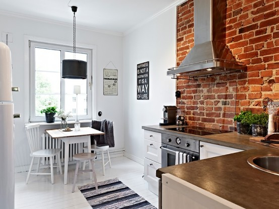 dettaglioi parete cucina stylish-kitchens-with-brick-walls-and-ceilings-43-554x415