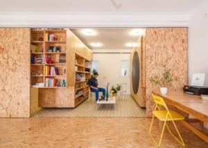 arch, Il materiale scelto, oriented strand board (OSB), rende il progetto estremamente economico, mentre anche l'aggiunta di alcune texture e calore alla stanza.