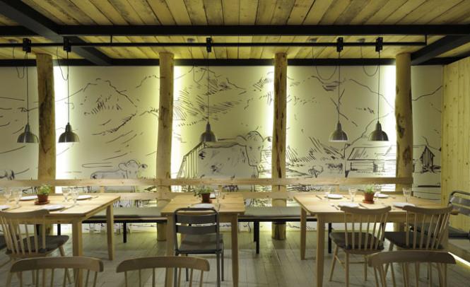 interno il ristorante farm kreaton, fattoria della carne si trova in Grecia ed è opera dell'arch. minaskosmidis dalle line semplici la grafica alle pareti è del disegnat.yannis tokalatsidis