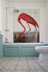 bagno red flamingo wall tiles in white bathroom with blue wanescotting and decorative floor tiles