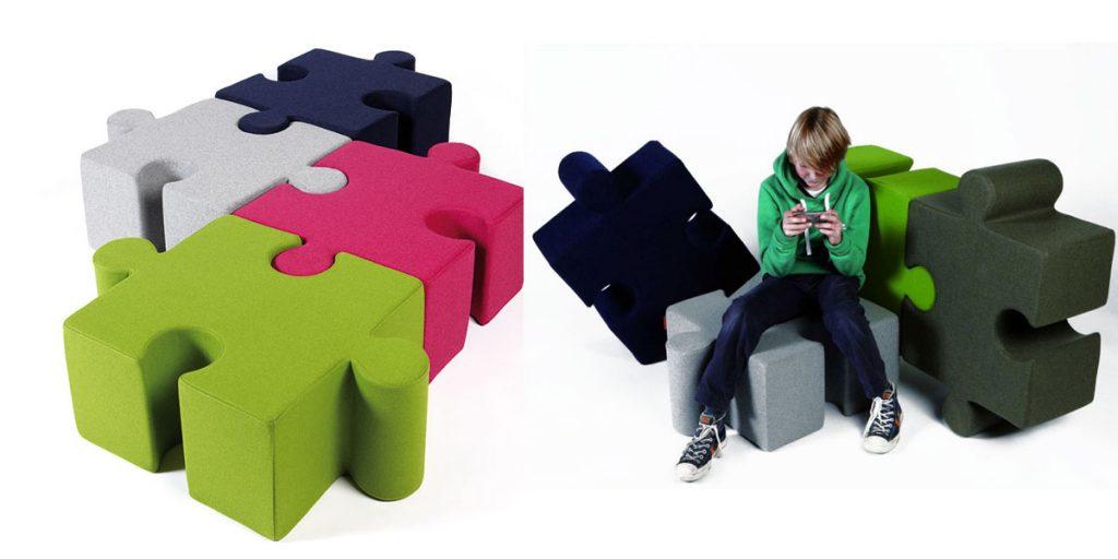 Pouf a forma di Puzzle rivestito in feltro, con la doppia funzione di seduta e di isolamento acustico. Componili come vuoi per creare una seduta senza limiti di grandezza per buzzi space